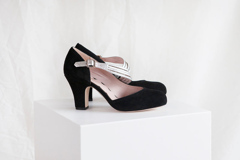 Lana by Miss L Fire is a vintage inspired black suede d'Orsay cut heeled pump with silver starburst strap.