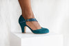 Lana by Miss L Fire is a vintage inspired teal green suede D'orsay cut heeled pump with teal metallic starburst strap.