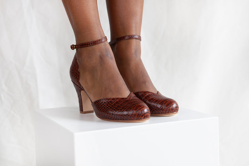 Layla in luxurious chocolate croc leather is a two part heeled shoe with adjustable ankle strap by Miss L Fire. Vintage inspired, ethically produced.