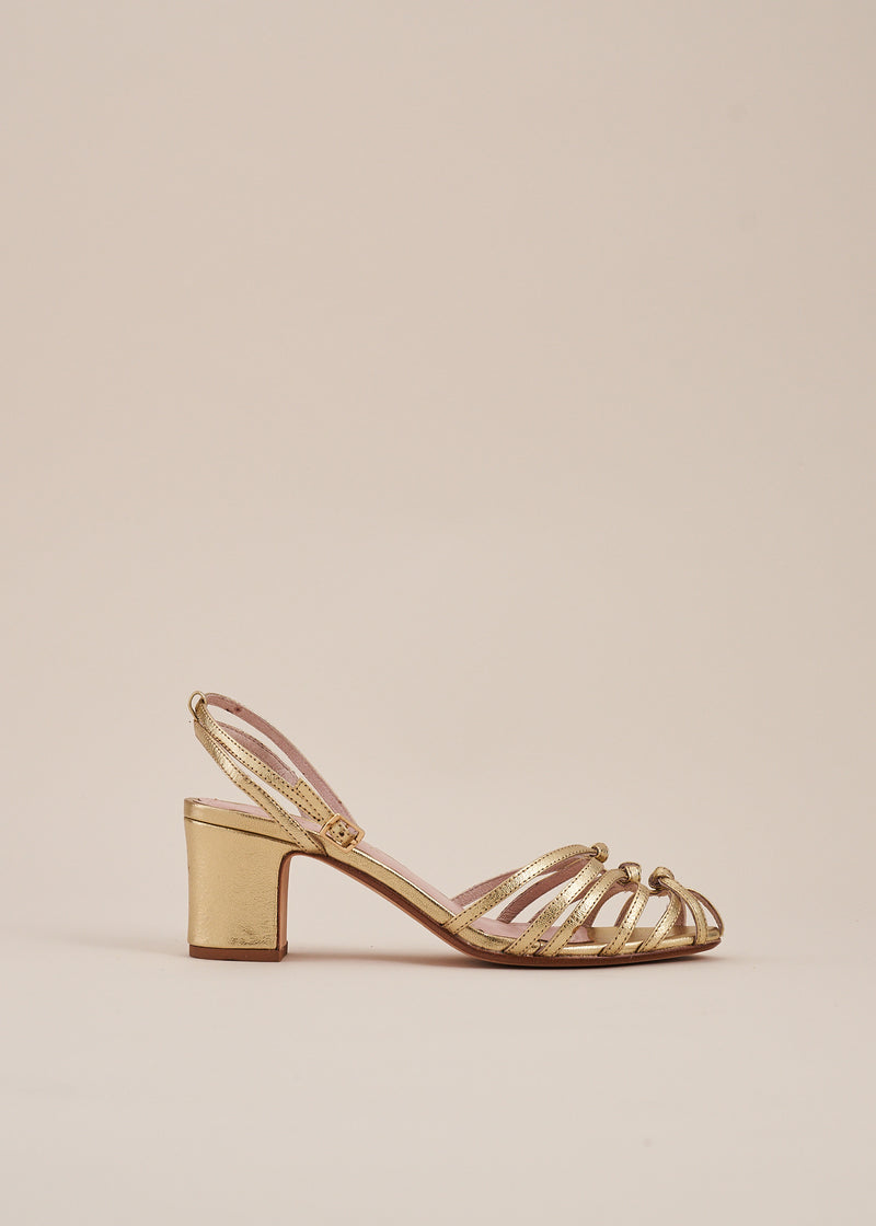Lois by Miss L Fire is a strappy knotted upper sandal in soft pale gold leather by London Designer, Miss L Fire. Perfect wedding heels. Small batch, ethically produced.