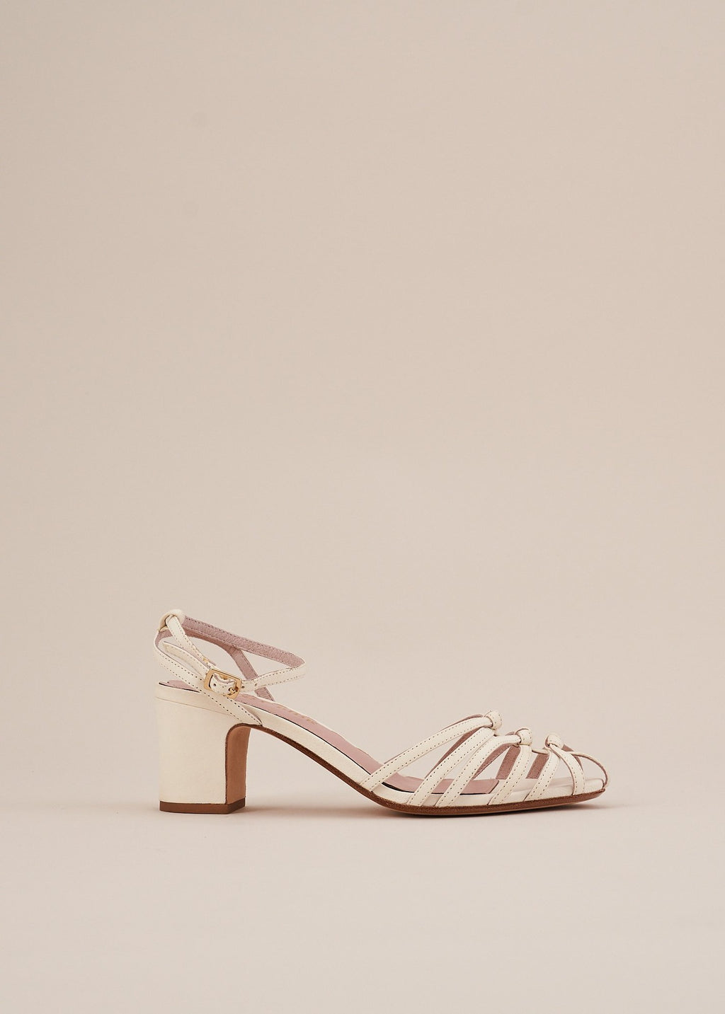 Lois by Miss L Fire is a strappy knotted upper sandal in soft white leather by London Designer, Miss L Fire. Perfect bridal wedding bridesmaid sandal. Small batch, ethically produced.
