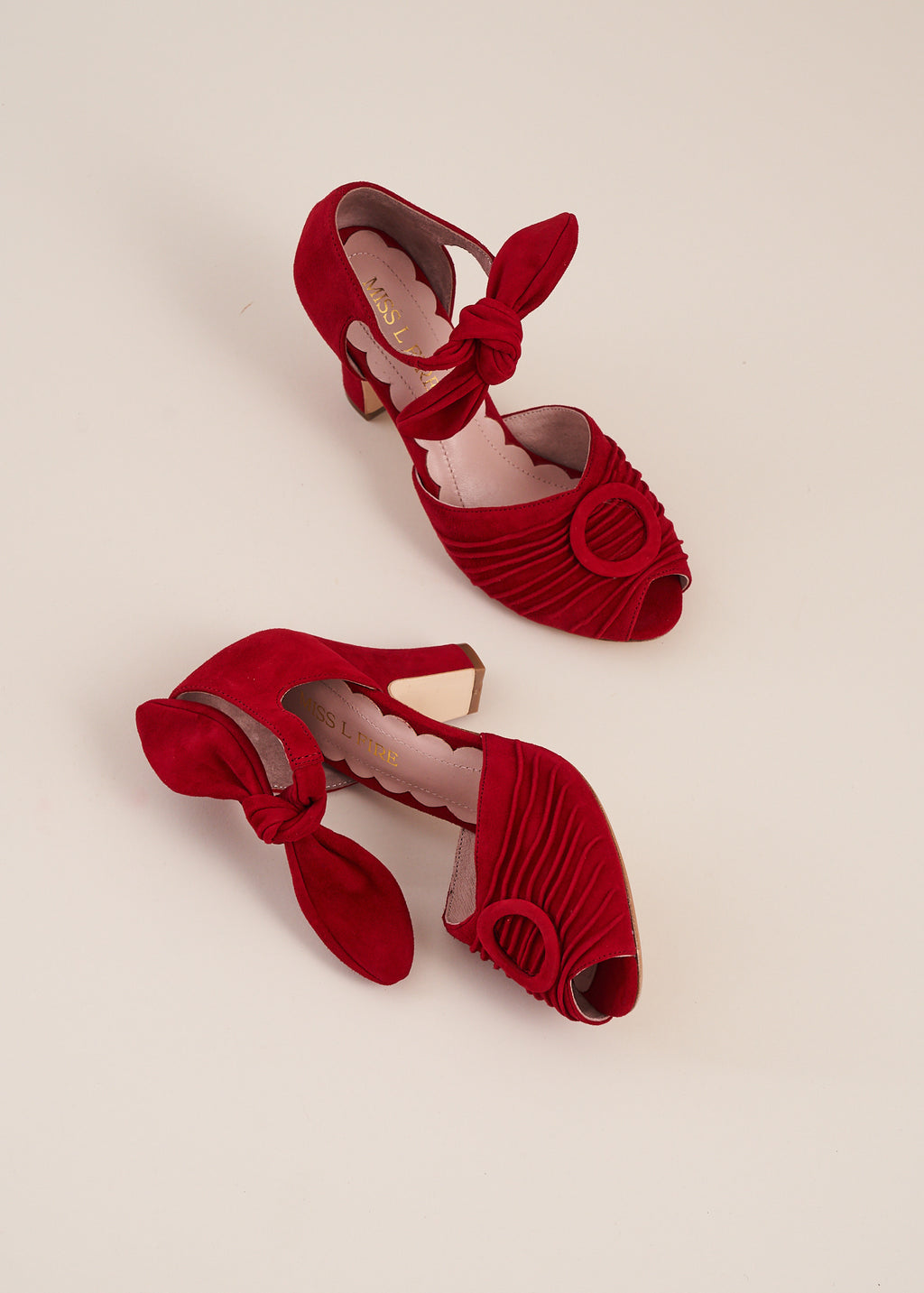 Loretta ruby red peep toe suede sandal with ruched detail and tie straps. Vintage inspired, always ethically produced.