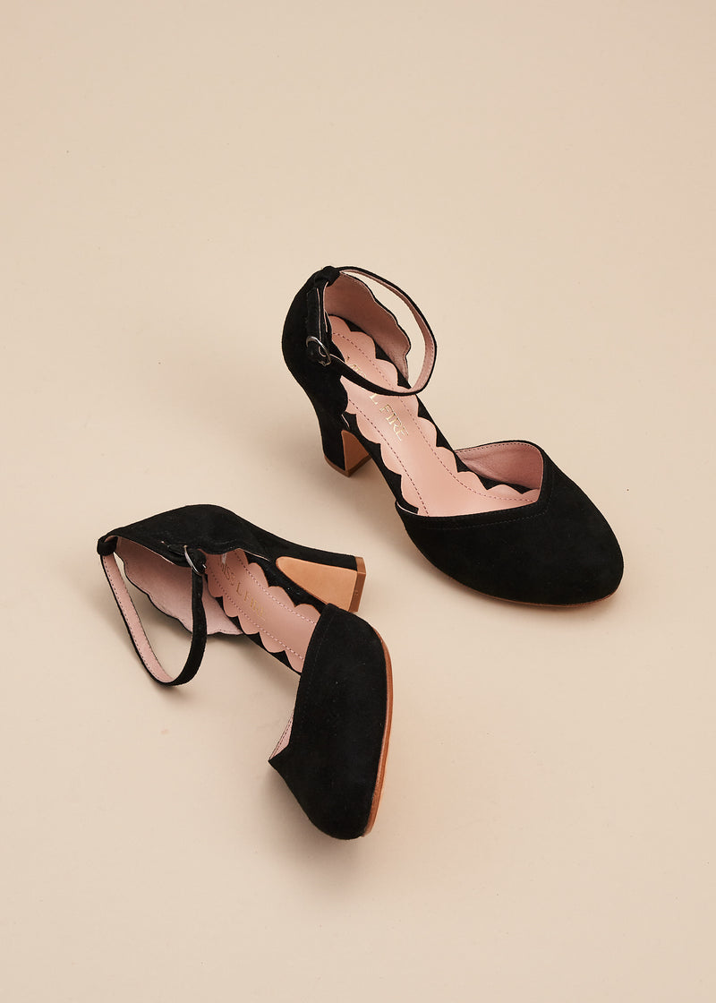Layla, by Miss L Fire,  in soft black suede is our go-to, every day, vintage inspired two part bar shoe with 'v' shaped topline, adjustable ankle strap, 8cm curved heel and cute scalloped detail. Wear at home, or plan a future party. Either way, prepare to dance all night in this classic style.