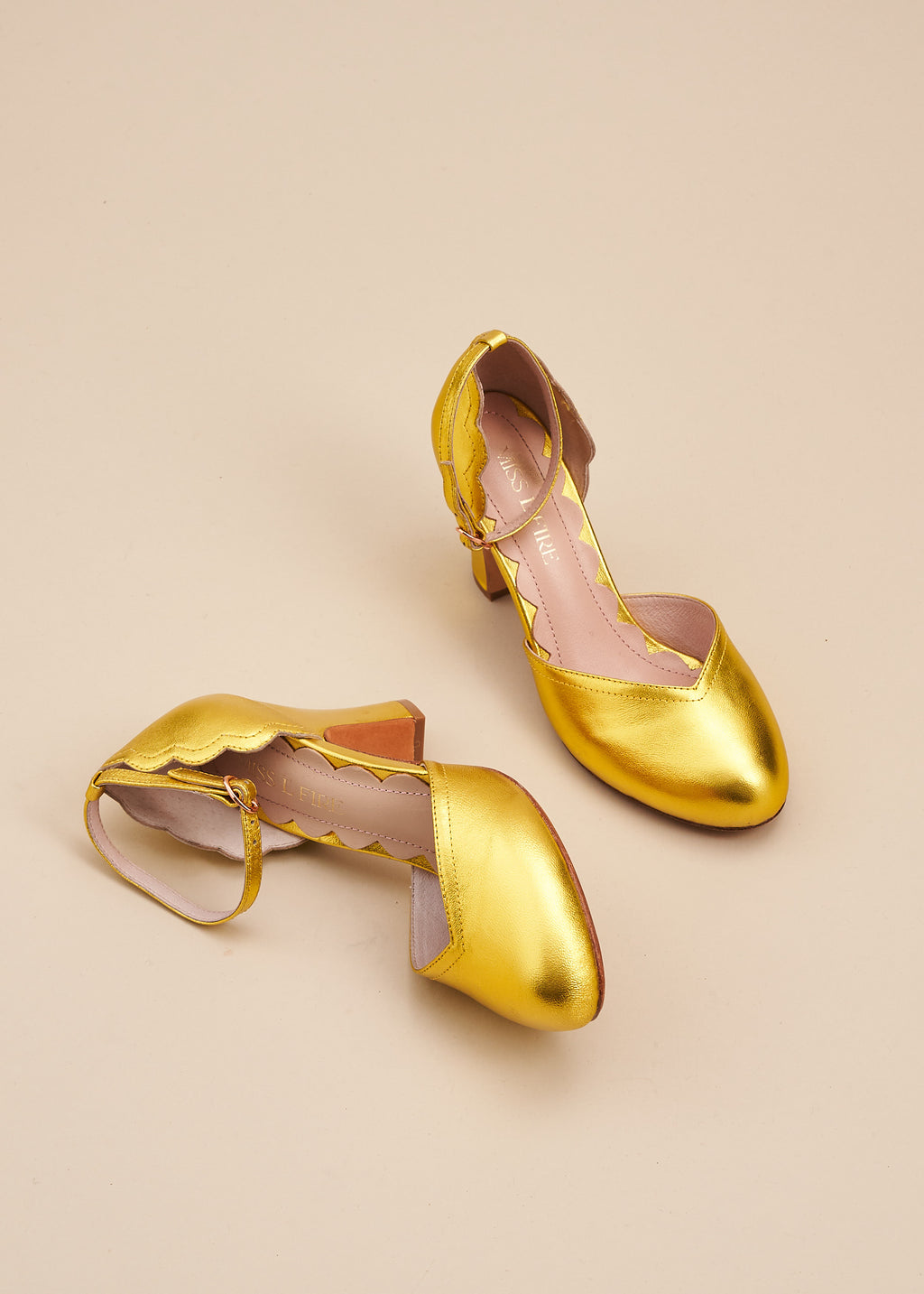 Layla, by Miss L Fire,  in luxurious gold metallic leather is our go-to, every day, vintage inspired two part bar shoe with 'v' shaped topline, adjustable ankle strap, 8cm curved heel and cute scalloped detail. Wear at home, or plan a future party. Either way, prepare to dance all night in this classic style.