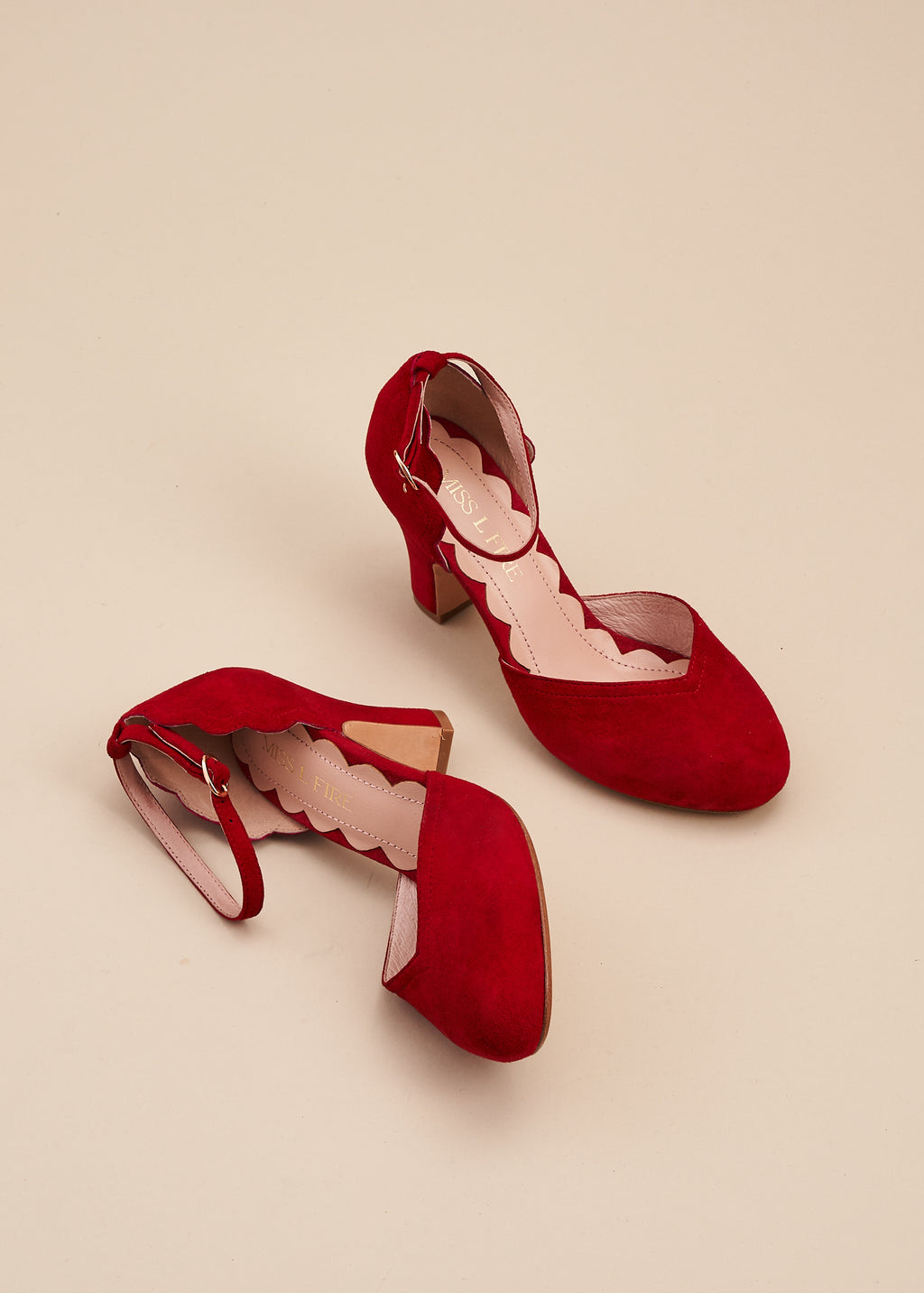 Layla, by Miss L Fire,  in soft ruby red suede is our go-to, every day, vintage inspired two part bar shoe with 'v' shaped topline, adjustable ankle strap, 8cm curved heel and cute scalloped detail. Wear at home, or plan a future party. Either way, prepare to dance all night in this classic style.