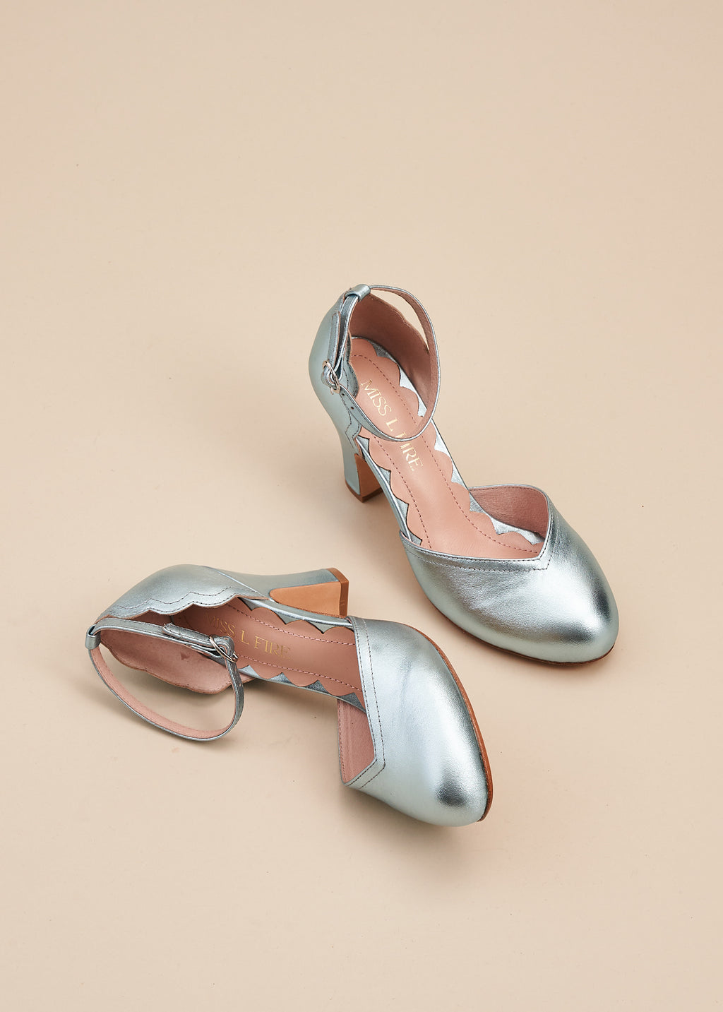 Layla, by Miss L Fire,  in luxurious sky blue metallic leather is our go-to, every day, vintage inspired two part bar shoe with 'v' shaped topline, adjustable ankle strap, 8cm curved heel and cute scalloped detail. Wear at home, or plan a future party. Either way, prepare to dance all night in this classic style.