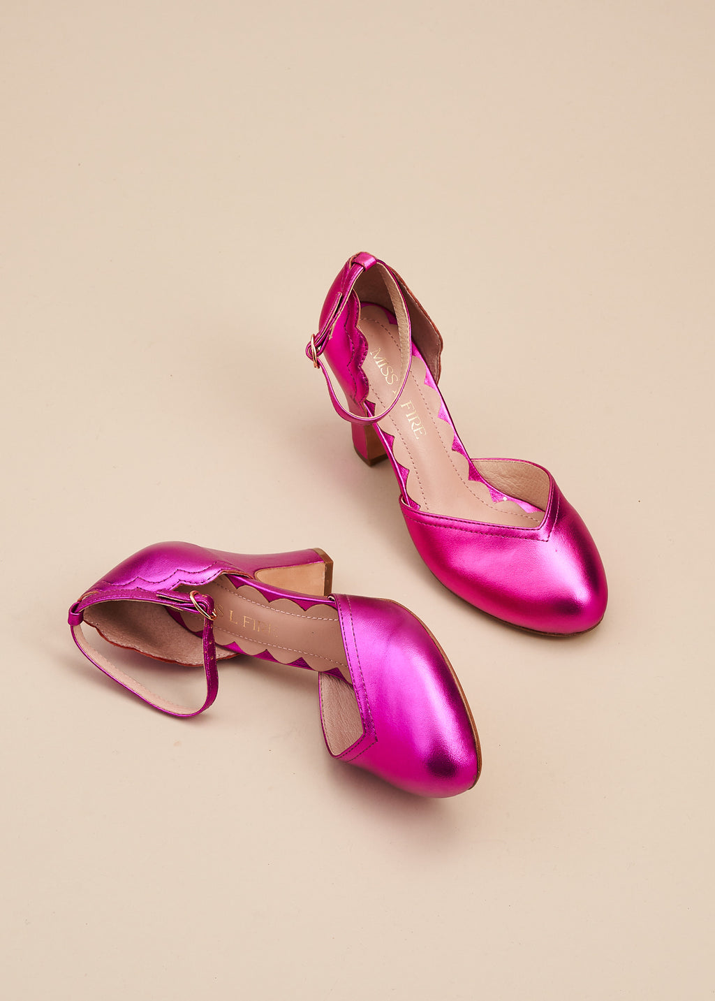 Layla, by Miss L Fire,  in beautiful violet metallic leather is our go-to, every day, vintage inspired two part bar shoe with 'v' shaped topline, adjustable ankle strap, 8cm curved heel and cute scalloped detail. Wear at home, or plan a future party. Either way, prepare to dance all night in this classic style.