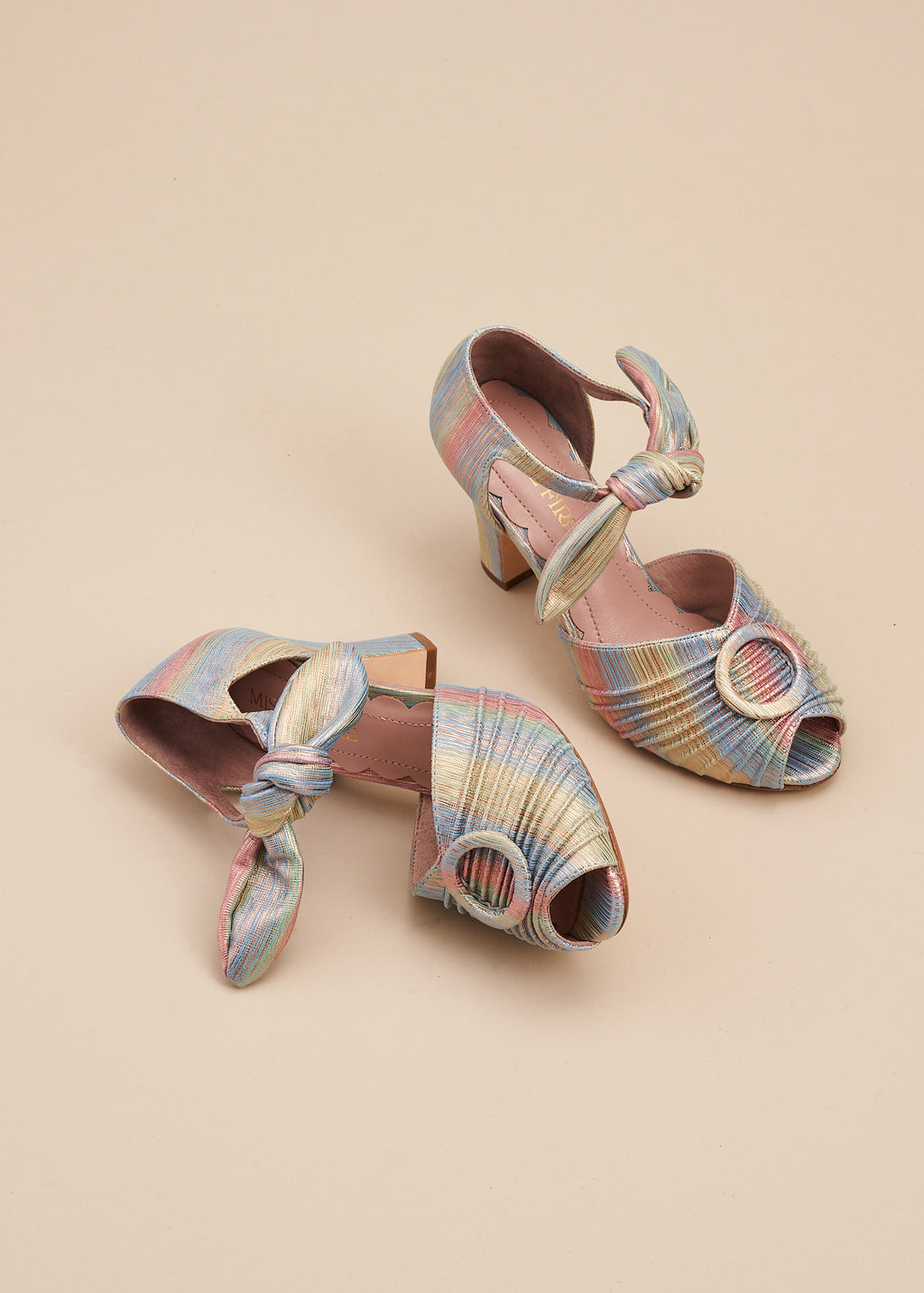 Loretta in gorgeous pastel stripe leather by Miss L Fire is a vintage inspired peep toe sandal with 8cm heel and soft ankle tie straps. Vamp features delicate pleating and covered buckle detail.