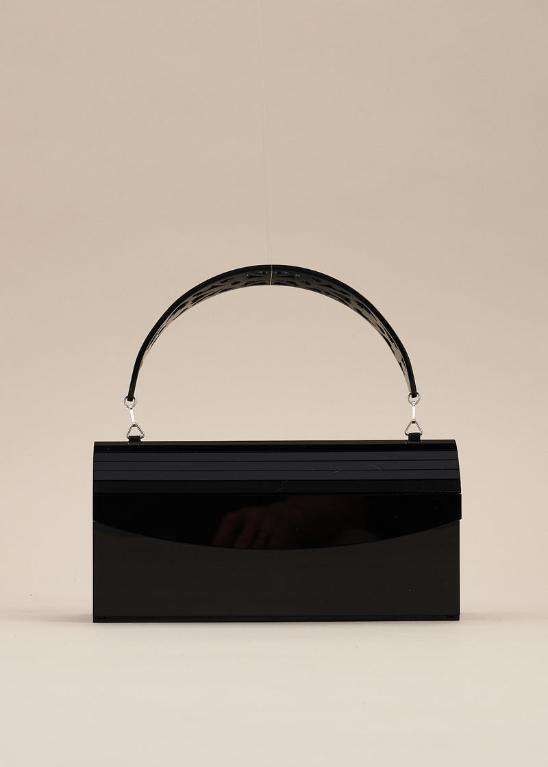 Francesca is a beautiful jet black lucite box handbag with detachable carved handle. This handbag can also be worn as a clutch bag. By designer Miss L Fire.