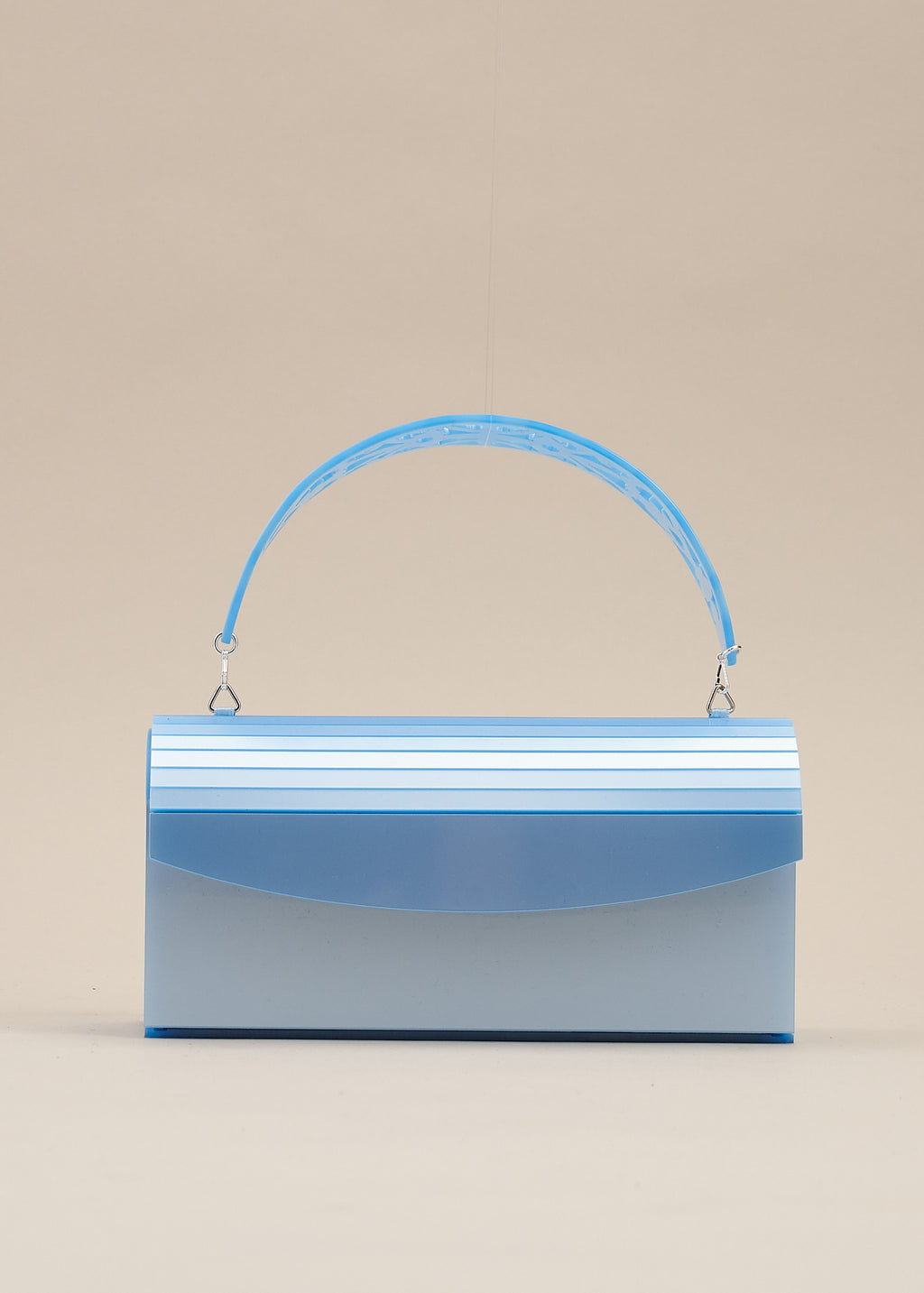 Francesca is a beautiful sky blue lucite box purse with intricately carved detachable handle. Can also be worn as a clutch bag. By designer Miss L Fire.