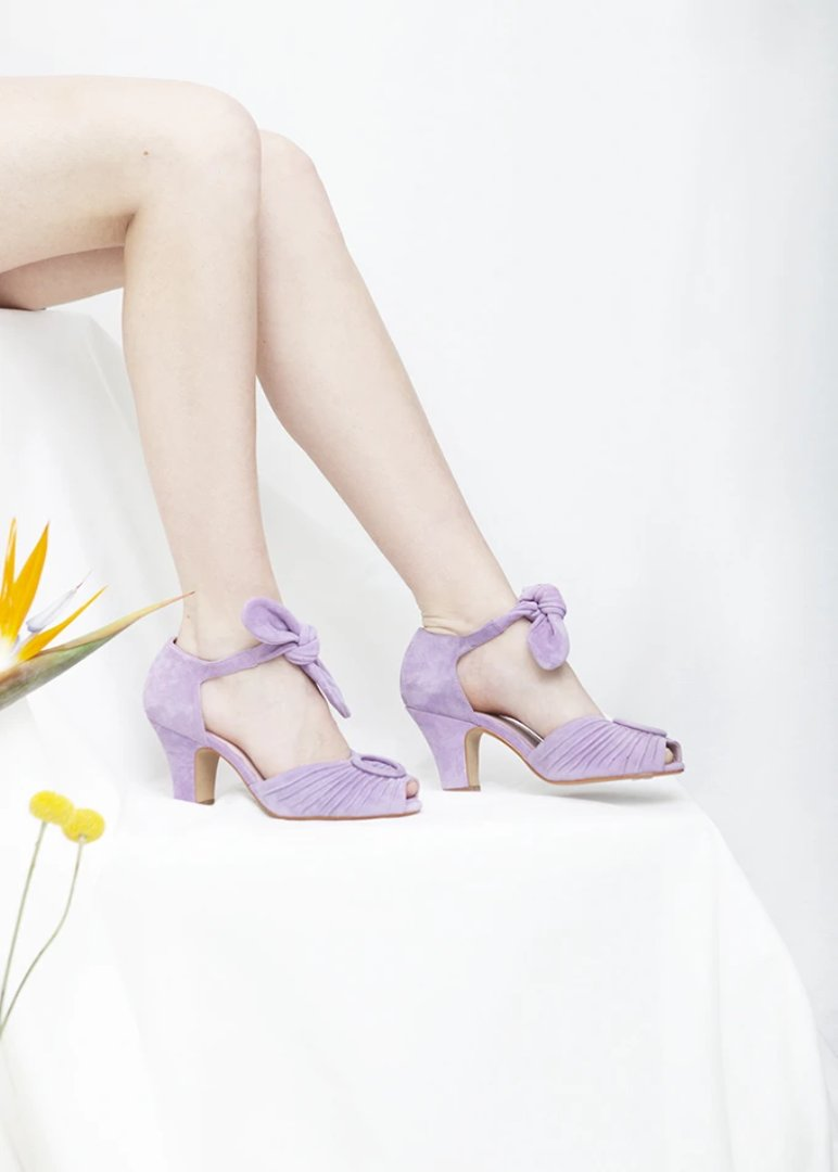 Loretta soft lilac peep toe suede sandal with ruched detail and tie straps. Vintage inspired, always ethically produced.