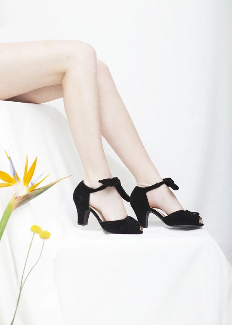 Loretta luxe black suede peep toe sandal with ruched detail and tie straps. Vintage inspired, always ethically produced.