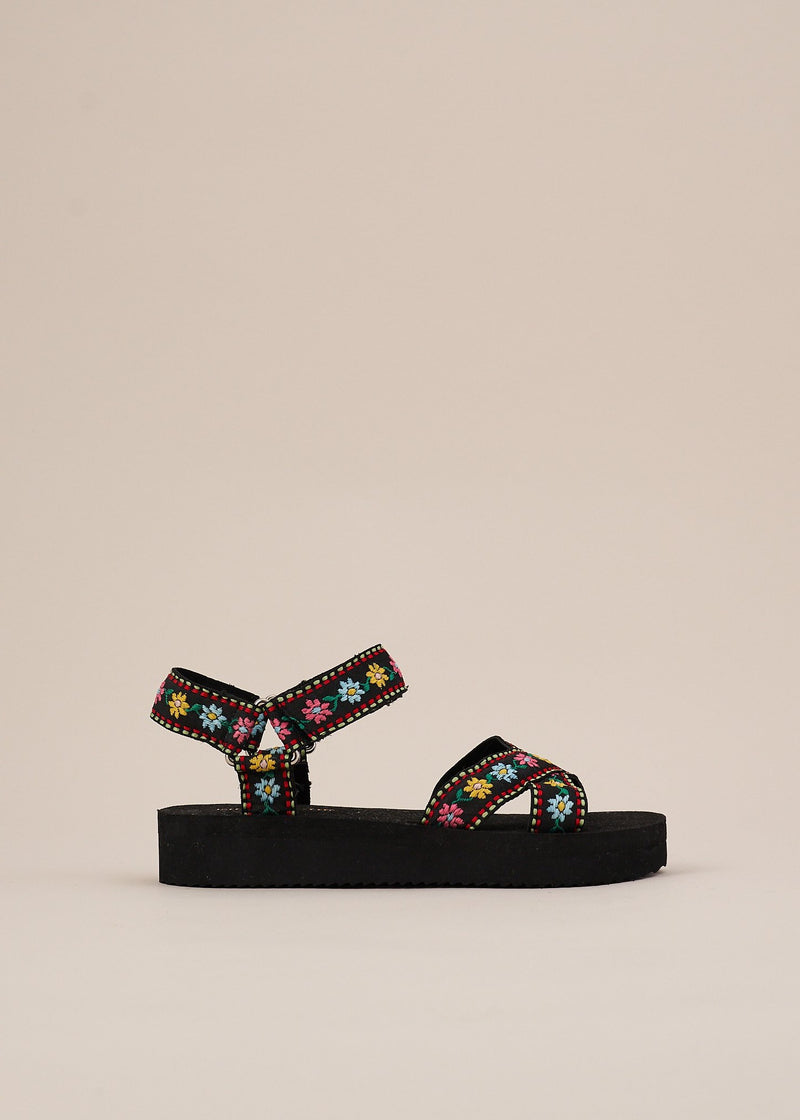 Michiko in black is the Miss L Fire take on a classic sports sandal. Adjustable velcro straps with unique floral embroidery. Insanely comfortable.  Very limited edition. Always ethically produced.