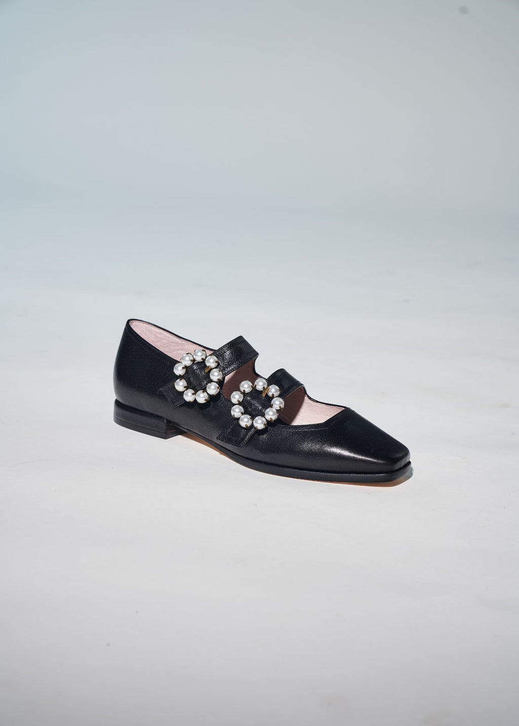 Molly black double strap flat with pearl buckle detail.