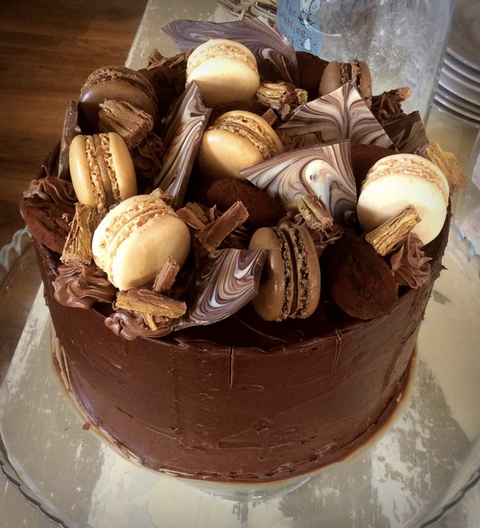 Chocolate cake topped with macaroons, marble chocolate shards & dark chocolate truffles