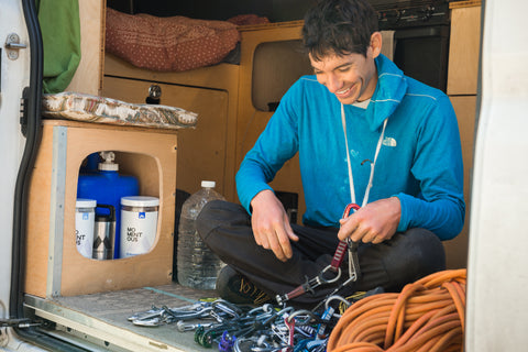 Rock climber Alex Honnold in his van preparing Momentous whey protein