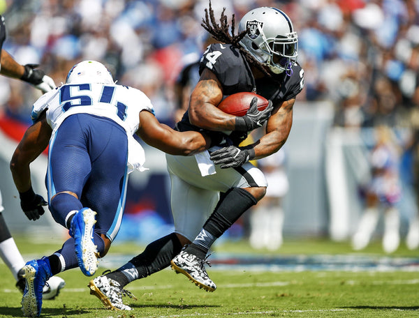 Marshawn Lynch wears Strideline Socks in Game vs. Titans