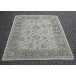 Beige and Celadon Border Oushak Rug