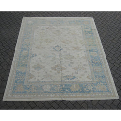 Ivory and Blue Oushak Rug