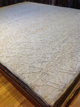 Beige and Cream High Low Area Rug