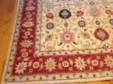 Traditional Rug with Red Border