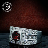 Men's Elegant Sterling Silver .925 High Polish Ring Featuring a Synthetic Red Ruby Center Stone Surrounded by 26 Fancy Round Prong-Set Cubic Zirconia (CZ) Stones