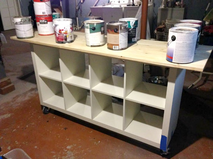 bookcase with paint cans