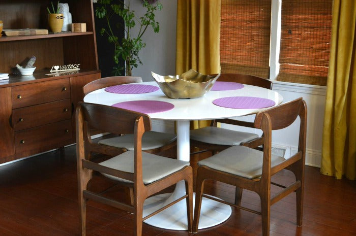 MAIN - white saarinen tulip style dining table on astralriles.com