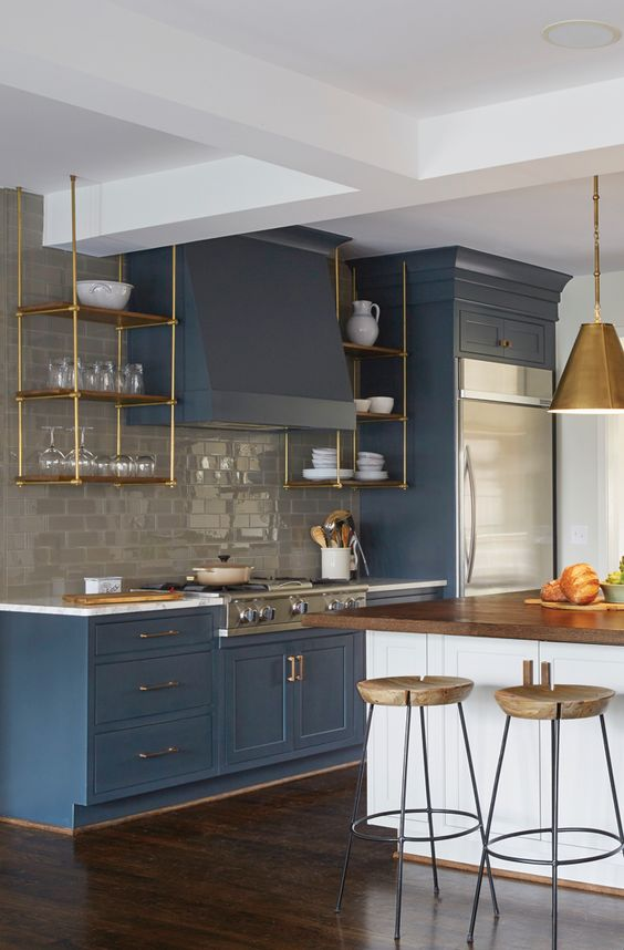birmingham home and design - blue kitcken with gold hardware on astral riles