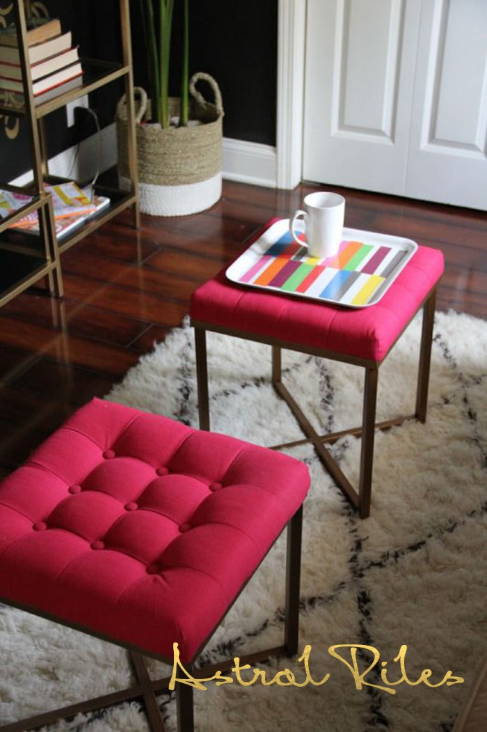 pink tufted ottomans on astralriles.com