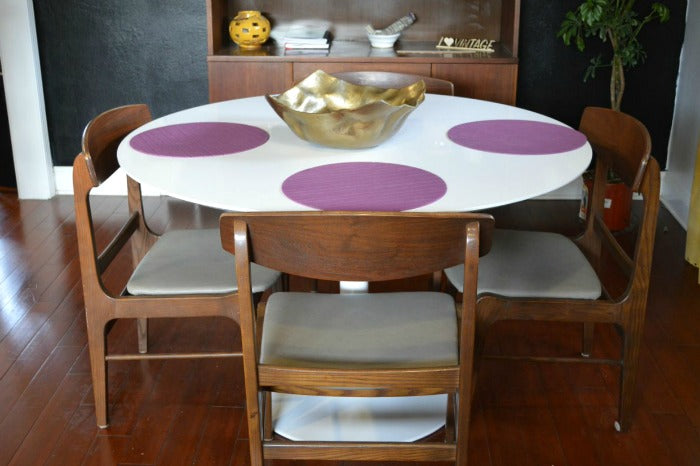 white saarinen tulip style dining table on astralriles.com 1