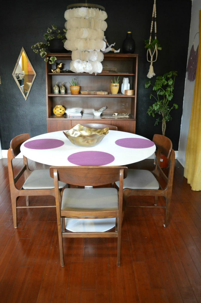 white saarinen tulip style dining table on astralriles.com 2