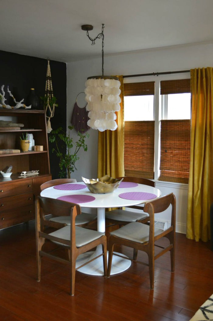 white saarinen tulip style dining table on astralriles.com