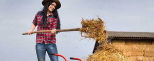 woman on farm spreading hay