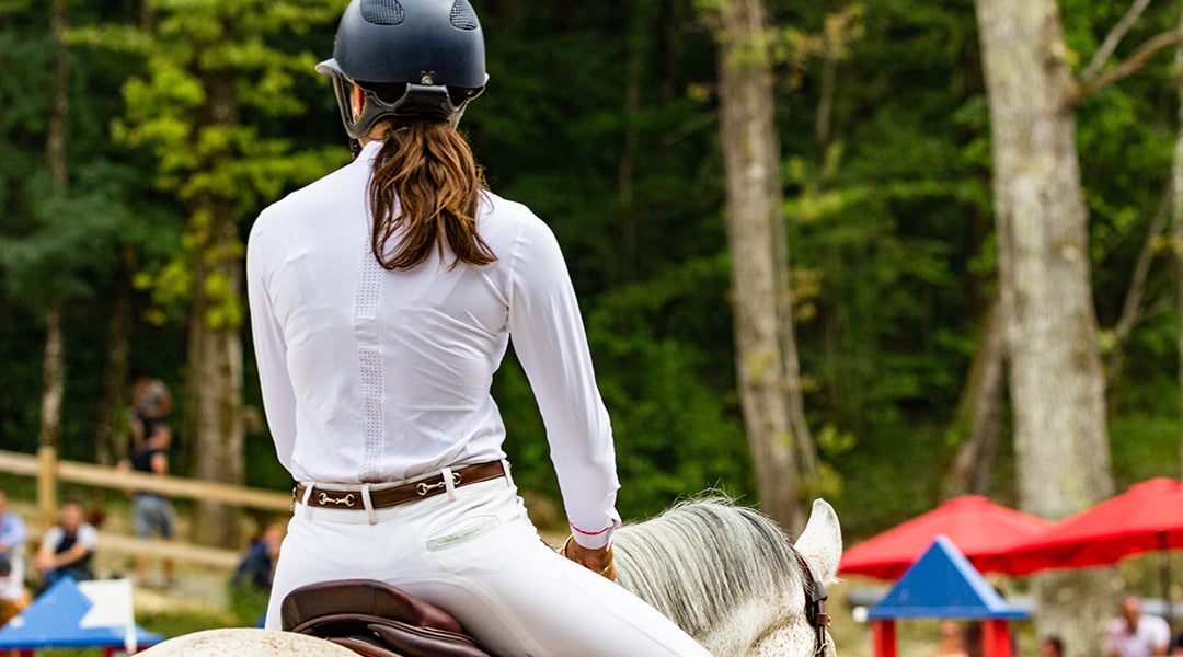 woman riding at horse event