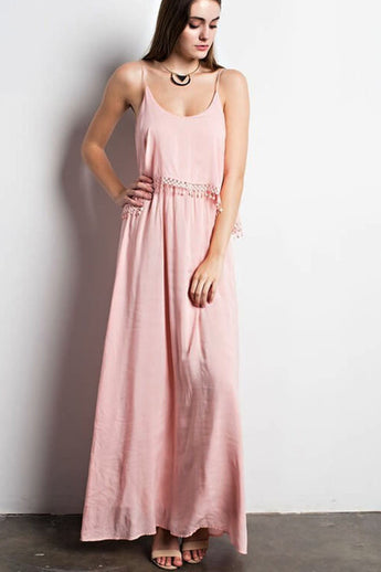Carey Maxi Dress - shows off a crepe layered look on the top with tassel details.- Lucy and Lou Boutique - www.lucyandlou.com