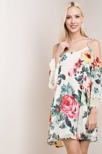 Flower Power Cold Shoulder Floral Dress - features eyelash lash on the sleeves with adjustable straps. This dress is lined, non sheer. Tie detail on the upper back - Lucy and Lou Boutique - www.lucyandlou.com