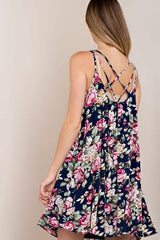 Your Vice Floral Navy Dress - features a multi criss cross detail on the back. It is a floral print with a navy background - Lucy and Lou Boutique - www.lucyandlou.com
