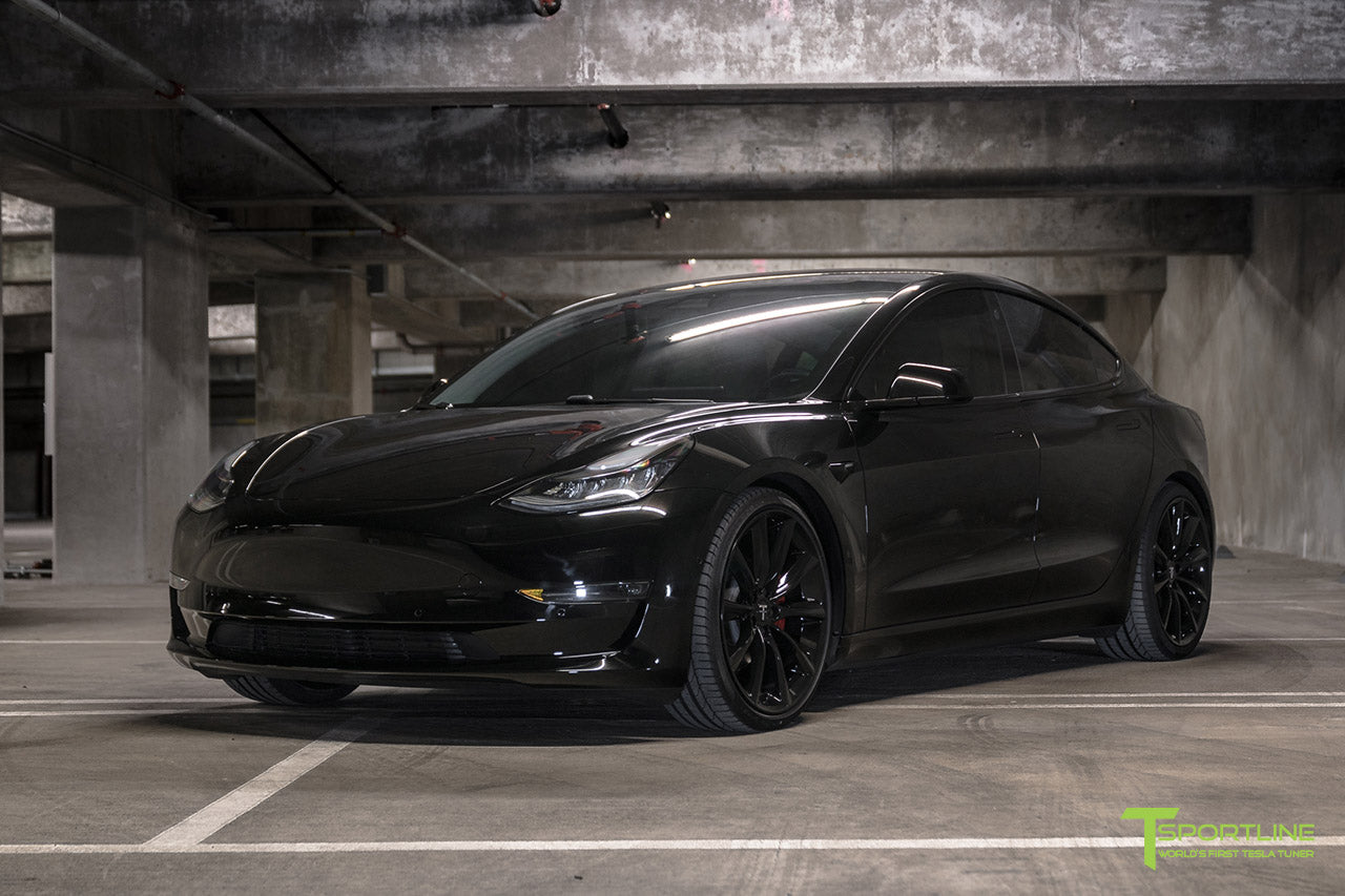 Murdered Out Black Tesla Model 3 with Gloss Black Chrome Delete, Window Tint, Gloss Black 20 inch Turbine Style TST Wheels, Gloss Carbon Fiber Trunk Wing, and Lug Nut Cover by T Sportline 8