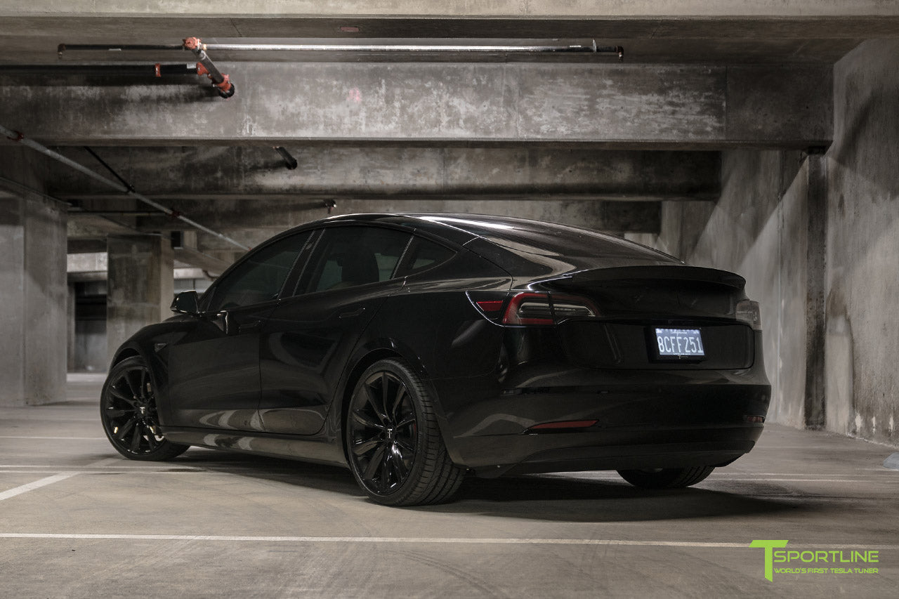 Murdered Out Black Tesla Model 3 with Gloss Black Chrome Delete, Window Tint, Gloss Black 20 inch Turbine Style TST Wheels, Gloss Carbon Fiber Trunk Wing, and Lug Nut Cover by T Sportline 6