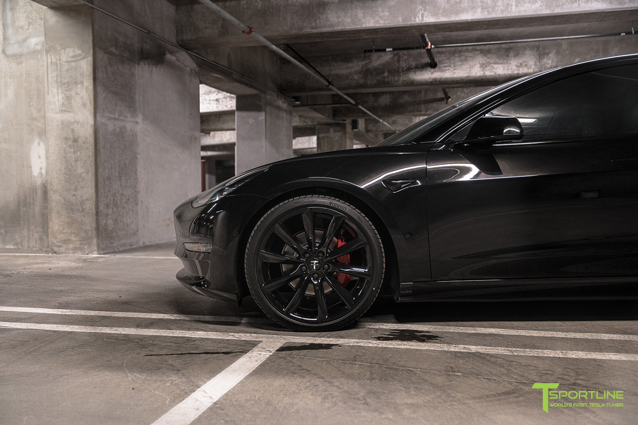 Murdered Out Black Tesla Model 3 with Gloss Black Chrome Delete, Window Tint, Gloss Black 20 inch Turbine Style TST Wheels, Gloss Carbon Fiber Trunk Wing, and Lug Nut Cover by T Sportline 5