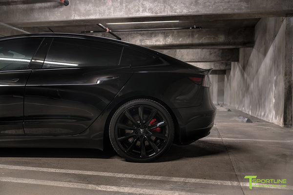 Murdered Out Black Tesla Model 3 with Gloss Black Chrome Delete, Window Tint, Gloss Black 20 inch Turbine Style TST Wheels, Gloss Carbon Fiber Trunk Wing, and Lug Nut Cover by T Sportline 4