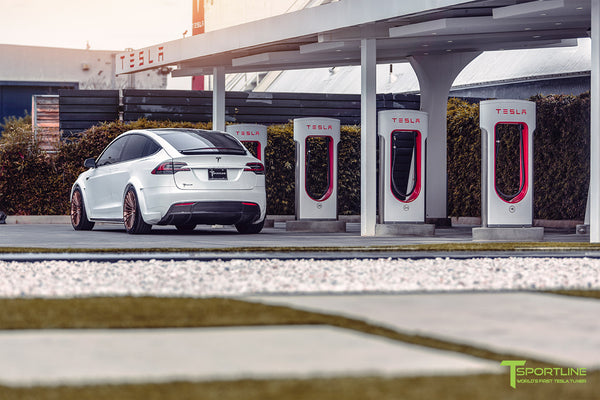 Pearl White Tesla Model X Limited Edition T Largo Wide Body Program with Brushed Bronze 22 inch Forged Wheels at Supercharger Station by T Sportline 1