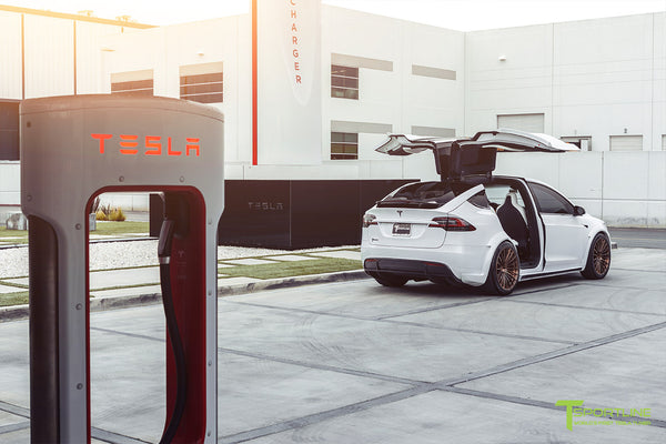 Pearl White Tesla Model X Limited Edition T Largo Wide Body Program with Brushed Bronze 22 inch Forged Wheels at Supercharger Station by T Sportline 2
