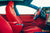 Project Superman v2 - 2020 Tesla Model S Performance with Superman-themed Tesla Model S Carbon Fiber Trim in Blue, Bentley Red Leather Interior, Blue Suede accents, and yellow seatbelts by T Sportline