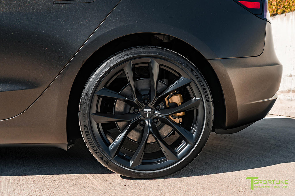 Black Model 3 with Custom Gold Brake Caliper Color and 20 inch TSS Arachnid Style Wheels