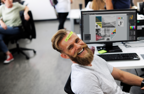 Man smiling while at his desk
