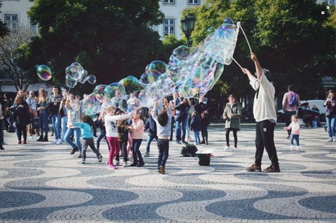 Children enjoying bubbles in a park