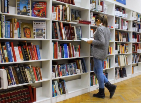 Person looking through a library