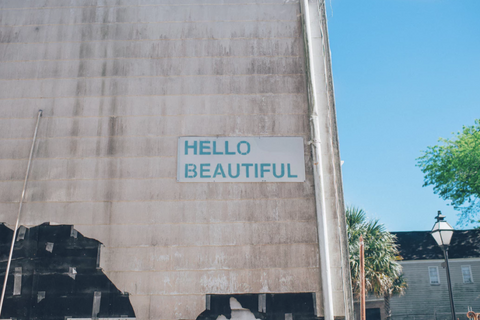 hello beautiful written on a wall